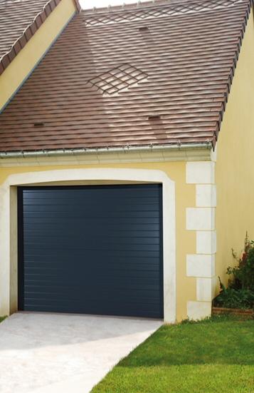 Porte de garage sectionnelle motoris e habitat discount for Porte de garage sectionnelle sur mesure lapeyre